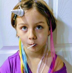 Girl with unicorn horn