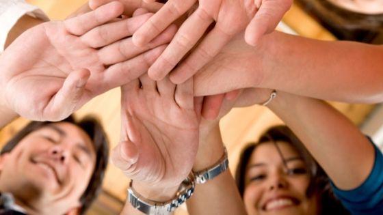 multiethnic hands clasped